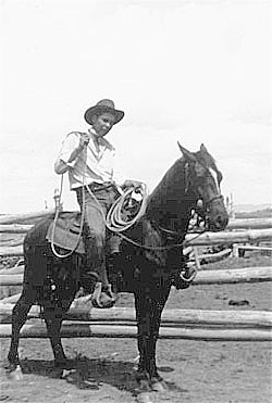 "Rusty Houtz in 1940, riding ""My first horse (of my own)."""
