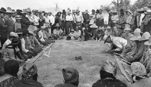 Kootenai and Blackfoot playing stick games at Sandpoint Beach , Idaho .